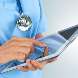 Healthcare staff using healthcare software solutions